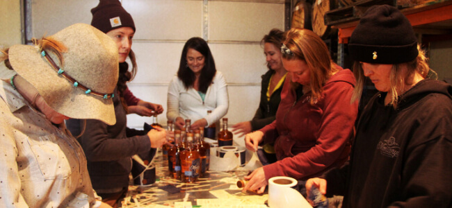 Karen Hoskins and her team bottling craft spirits by hand.