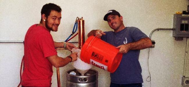 Two workers making small batch spirits together at Nightside Distillery.